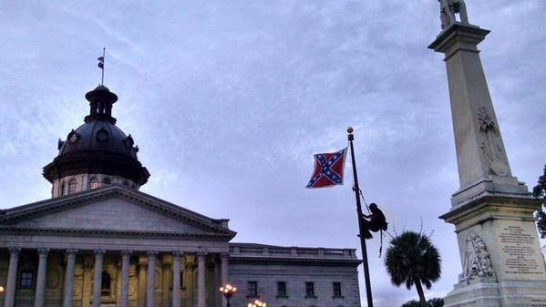 Bree Newsome (with support from local activists) scales the flag pole in front of South Carolina's courthouse in Charleston, and takes down the Confederate flag at dawn on June 27, 2015. She is immediately arrested. For updates follow #FreeBree, #BreeNewsome, @BreeNewsome on Twitter, ColorOfChange.org or @fergusonaction on Twitter. (Photo also needs a photographer credit: Please tag in comments)