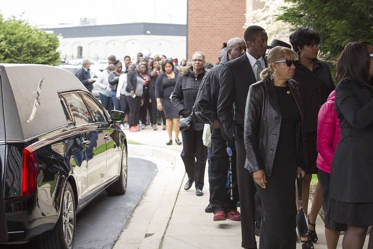 Mourners arrive at New Shiloh Baptist Church for the funeral services of Freddie Gray